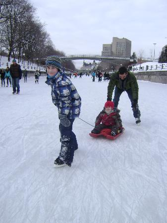 Rideau Canal: Tristan pulling little brother Owen on the canal