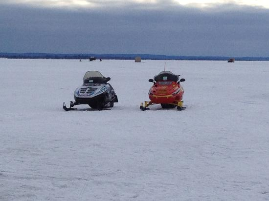 Adani Beach Retreat Bed & Breakfast: Snowmobiles on the lake out front of Adani