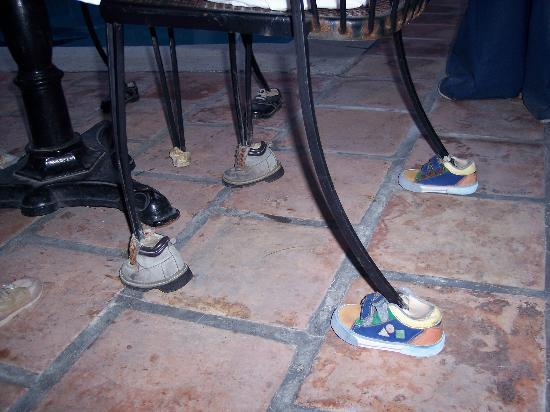 Bird Cage Restaurant : These chairs have shoes on their feet