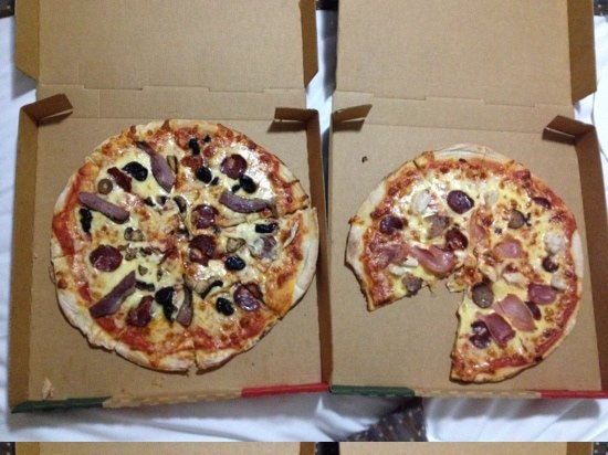 Angelo's On The Marina: these are the two pizzas that I paid $53.30 for! One piece is missing because my partner was sta