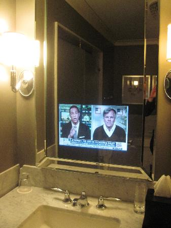 tv behind bathroom mirror elysian front lobby picture of waldorf astoria chicago 21060