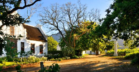 Vrede en Lust Winery: The Vrede en Lust Cape Dutch Manor House with historic cellar in background