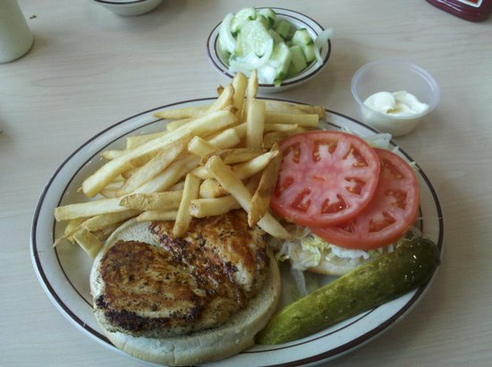 Sunrise Diner: Marinated chicken breast sandwich with lettuce and tomatoes and mayo on the side; french fries;