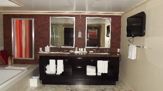 bathroom of our tower suite, his and hers sinks, bidet, big glass