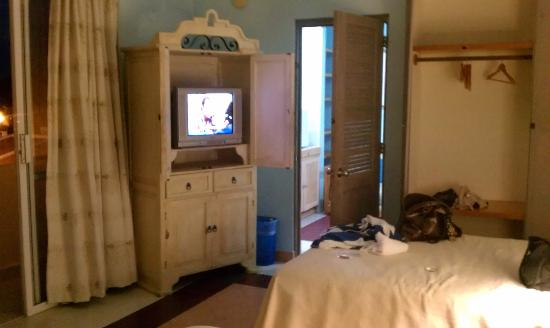Marisol Boutique Hotel: TV and closet, also not shown are a dresser and desk.