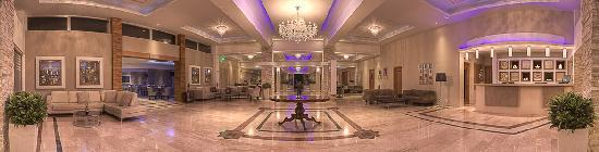 Asterias Beach Hotel: Lobby at Evening Panorama 2012
