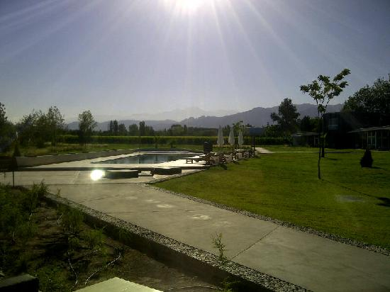 Entre Cielos: view of pool with vineyard and andes mountains in the background