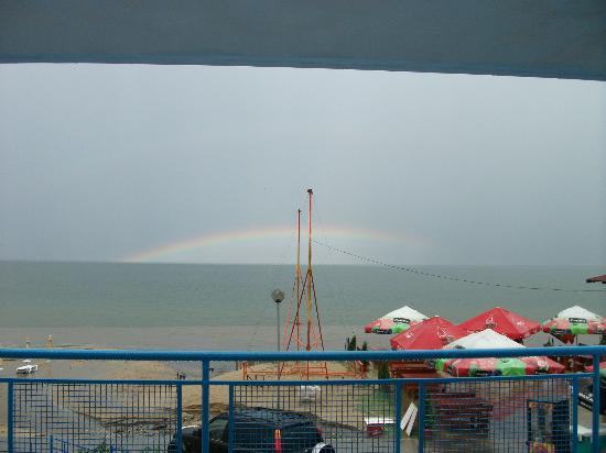 Helios Beach: view from our room, greeted by a storm and rainbow