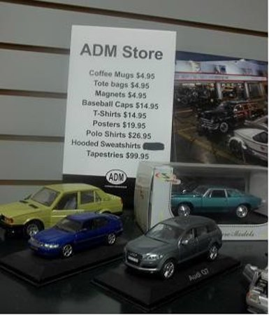 Automobile Driving Museum: Sign for the gift shop, merchandise for sale.
