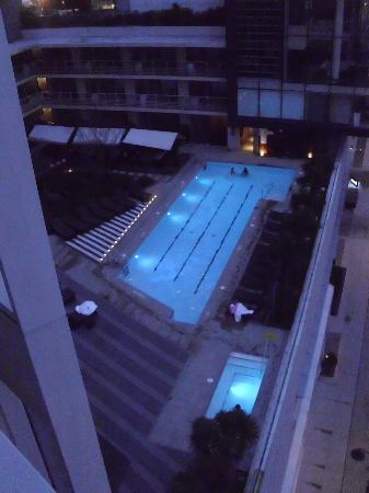 Fairmont Pacific Rim: view of the pool and hot tub from our room at night