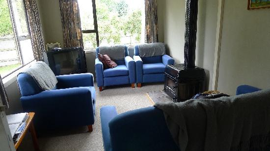 Birchwood Cottages: Living room and apple tree outside