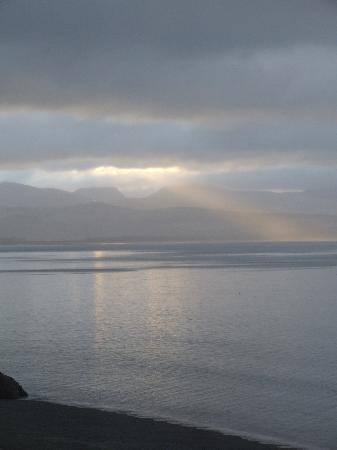 Seaspray : The sun rises over the Rhinogs and glints on the waters of Cardigan Bay..