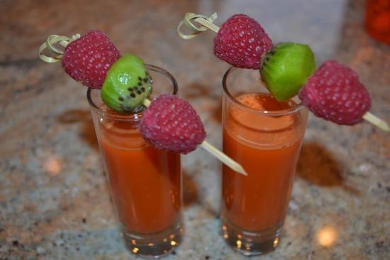 Adytum Sanctuary: Fresh juiced shooters with fruit garnish