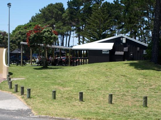 Whangamata Beach: Blackies Cafe in park metros from beach and surf club