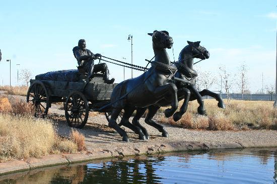 Centennial Land Run Monument : Staute of horses rearing near the water's edge.