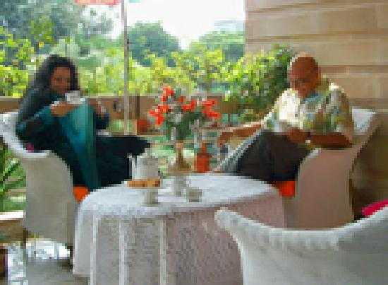 Srivastav Inn: Guest relaxing on the drawing room balconye