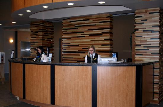 Prestige Treasure Cove: Our new front desk feature wall! And lovely front desk staff :)