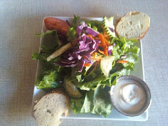 Rhojo's: Fresh Salads made at time of order, topped with your choice of made from scratch dressings
