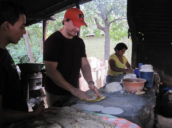 Nicaragua Asi Tours : my boyfriend making his first corn tortilla