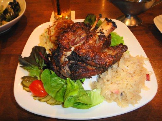Brotzeit German Bier Bar & Restaurant : Schweinshaxn / Pork Knuckle. Crispy hind shank of grain fed pork served with potato salad, sauer