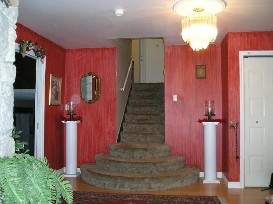 A Taste of Home Bed and Breakfast: stairs to Master's and Rose Rooms from foyer