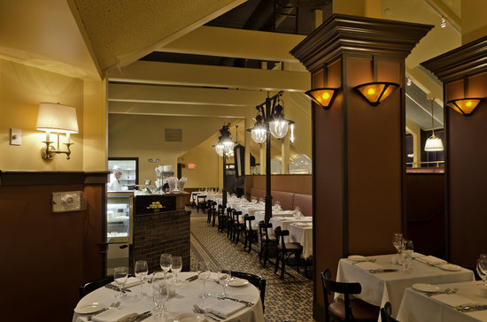 Brasserie L'Oustau : A view of the open kitchen from one of 4 intimate dining areas.