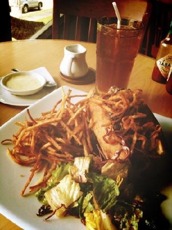 Warm prime rib sandwich with cheese sauce, potato strings & simple salad