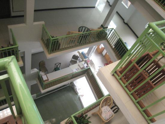 Dhevaraj Hotel: Looking down from our 'corridor' seating area to the floors below