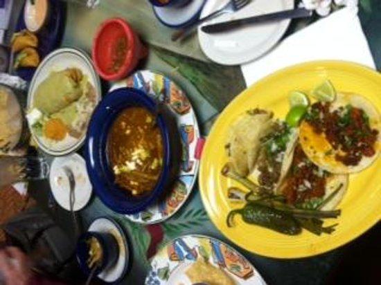 El Perico: Two pork belly and two chcorizo tacos, tortilla soup, chicken chimichanga and shrimp empanadas.