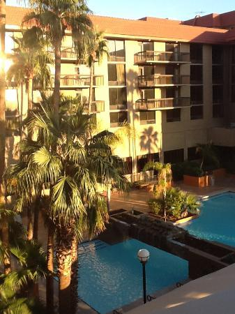 Holiday Inn Phoenix - Mesa/Chandler: View of the pool area from the doorway of room 454 in Suites Bulding.