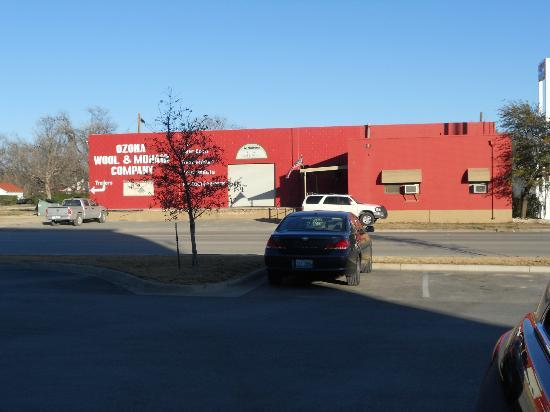 Holiday Inn Express Hotel & Suites Ozona: Building across street at front - quieter on this side
