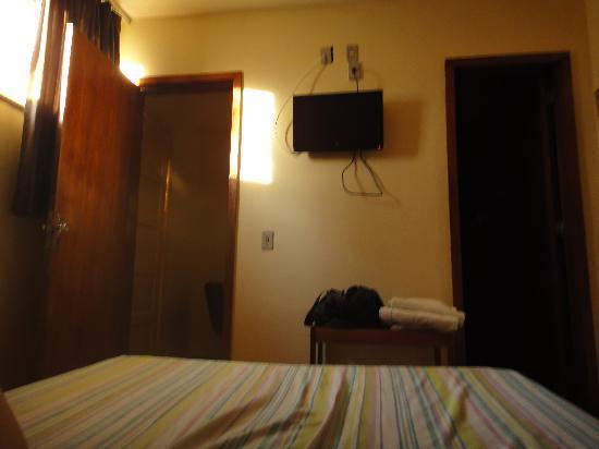 Hotel Americano: кровать