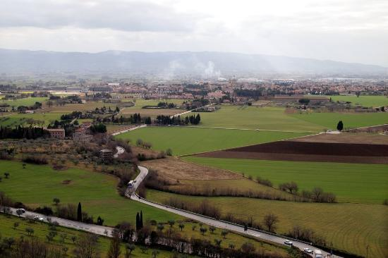 County House Il Roseto: This is a view from Assisi. You can probably see the Il Roseto in the middle of the field there.
