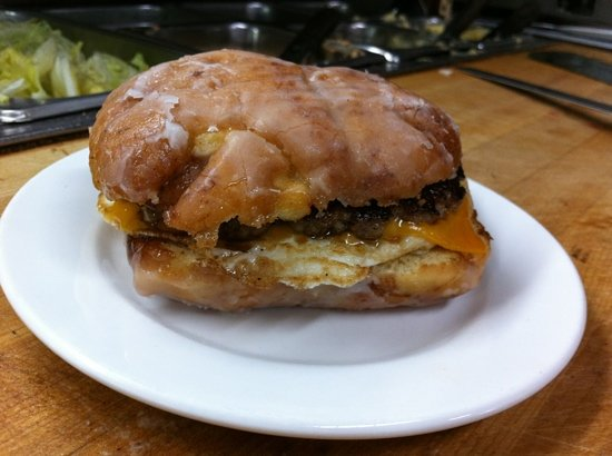 Hilltop Diner Cafe: grilled apple fritter, homemade sausage pattie cheddar cheese and fried egg.