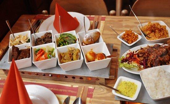Photo of Asian Restaurant Aneka Rasa at Warmoesstraat 25-29, Amsterdam 1012 HV, Netherlands