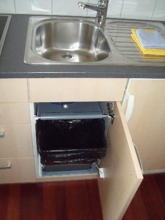 Accademia Apartments: The kitchen sink and garbage bin