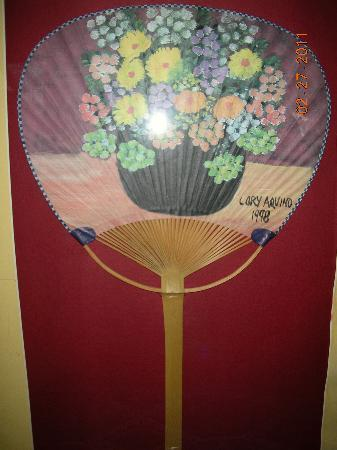 Abaseria Cafe and Deli: fan with handpainted flowers by the late Pres. Cory Aquino
