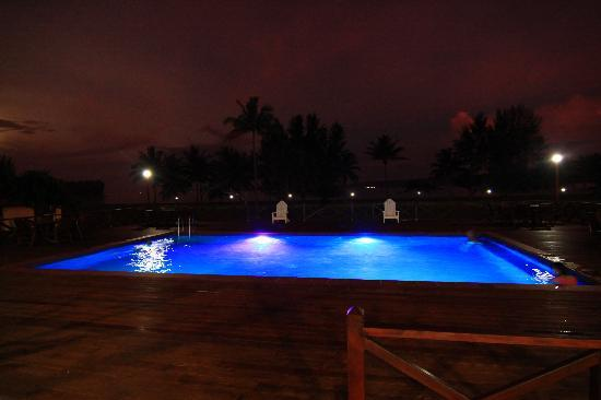 Beachfront Resort: Pool by night