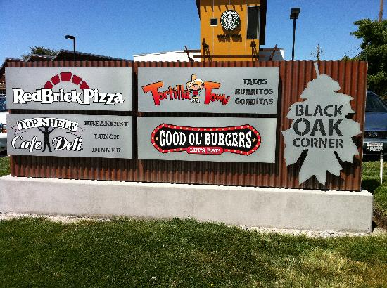 Red Brick Pizza : Street sign with other businesses in center