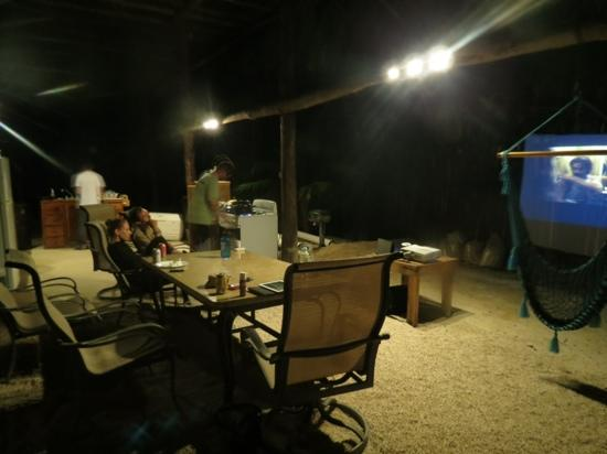 movie night at las palmas mayas in the outdoor kitchen/dining area