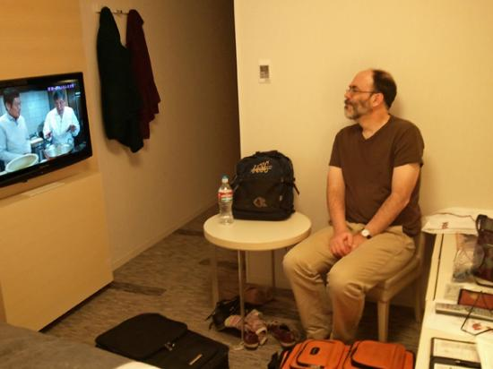 Richmond Hotel Narita: My husband in the child-sized chair in our tiny room.