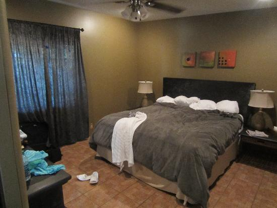 Master bedroom with sheer curtains - Picture of The Rossi ...