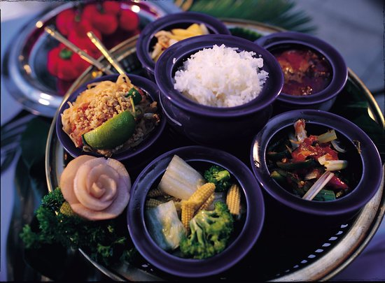 Shows a variety of colourful Thai food dishes