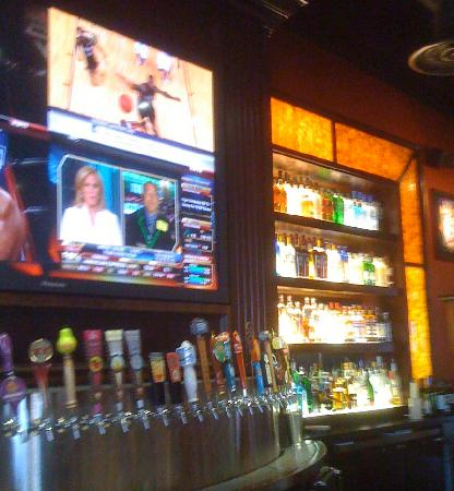 BJ's Restaurant & Brewhouse: Photo Across the Bar Showing Beer Tap Selection