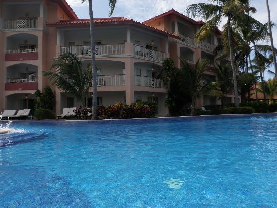 enjoying a pool float picture of majestic elegance punta. Black Bedroom Furniture Sets. Home Design Ideas