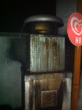 Courthouse Hotel: chimney vent from kitchen spewing grease and foul smells