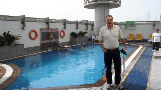 Vision Hotel Apartments: That's me at the pool
