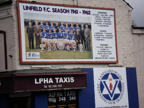 NI Black Taxi Tours: football mural on the shankill
