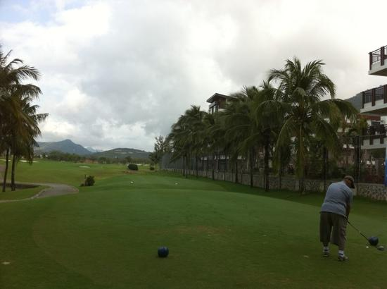 Yalong Bay Golf Club: the hole with a row of 3 level houses on the right. no slice allowed!