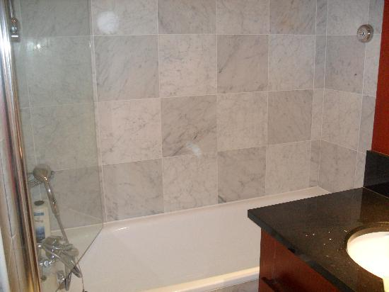 Residhome Val d'Europe: bath tub and has a shower cubical next to it...